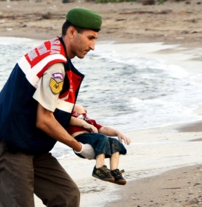 REFILE - CORRECTING BYLINEATTENTION EDITORS - VISUALS COVERAGE OF SCENES OF DEATH OR INJURYA Turkish gendarmerie carries a young migrant, who drowned in a failed attempt to sail to the Greek island of Kos, in the coastal town of Bodrum, Turkey, September 2, 2015. At least 11 migrants believed to be Syrians drowned as two boats sank after leaving southwest Turkey for the Greek island of Kos, Turkey's Dogan news agency reported on Wednesday. It said a boat carrying 16 Syrian migrants had sunk after leaving the Akyarlar area of the Bodrum peninsula, and seven people had died. Four people were rescued and the coastguard was continuing its search for five people still missing. Separately, a boat carrying six Syrians sank after leaving Akyarlar on the same route. Three children and one woman drowned and two people survived after reaching the shore in life jackets. VIA REUTERS