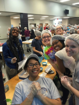 Heritage Seniors working together to pack food for the annual Stop Hunger Now event