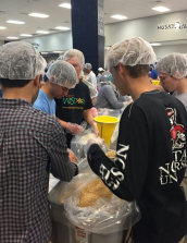 Teens pack soy protein for families in need.